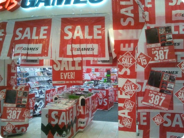 An EB Games store with almost every visible surface covered in Sale signs.